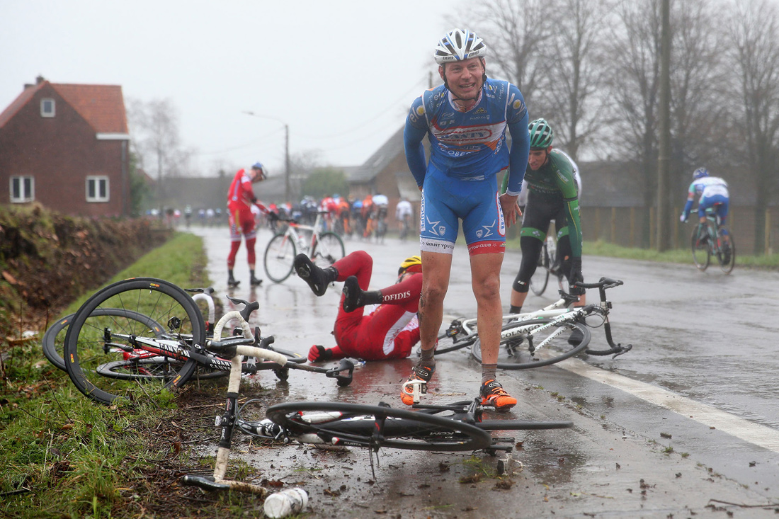 Laurens de Vreese grimaces in pain after a crash in the Omloop Het Nieuwsblad race, Ghent, Belgium, March 2014