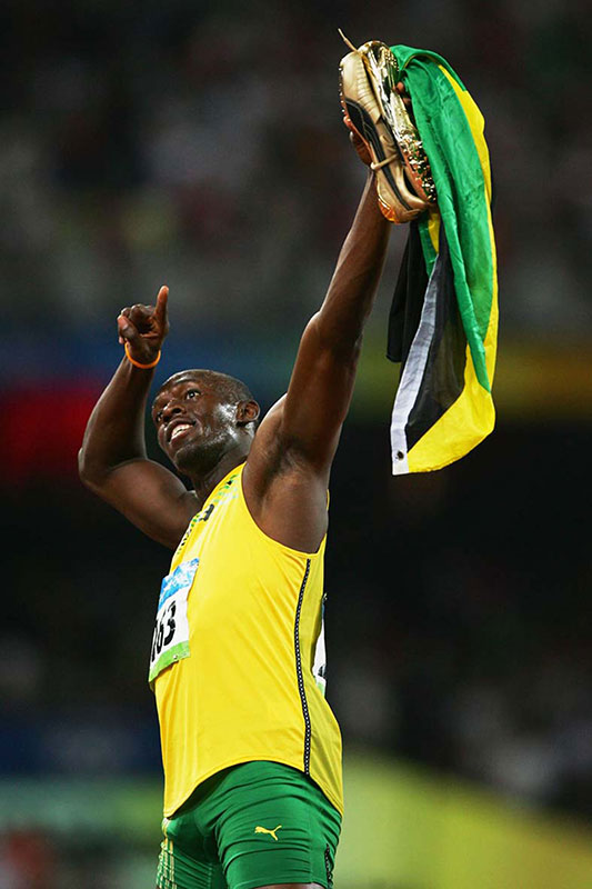 Usain Bolt celebrates winning gold in the men's 100m final, Beijing 2008 Olympics