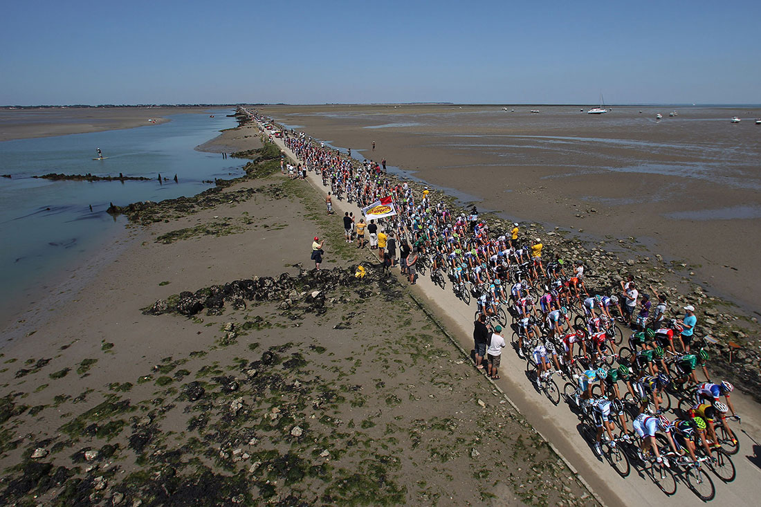 The peloton crosses the Passage du Gois, Stage One, Tour de France, July 2011