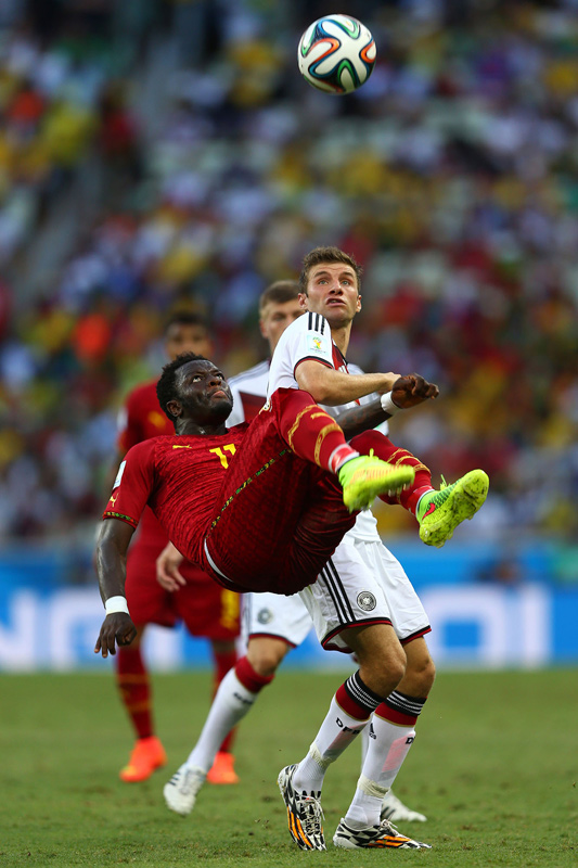 Sulley Muntari clears from Thomas Mueller, Ghana v Germany, FIFA World Cup, Fortaleza, Brazil, June 2014