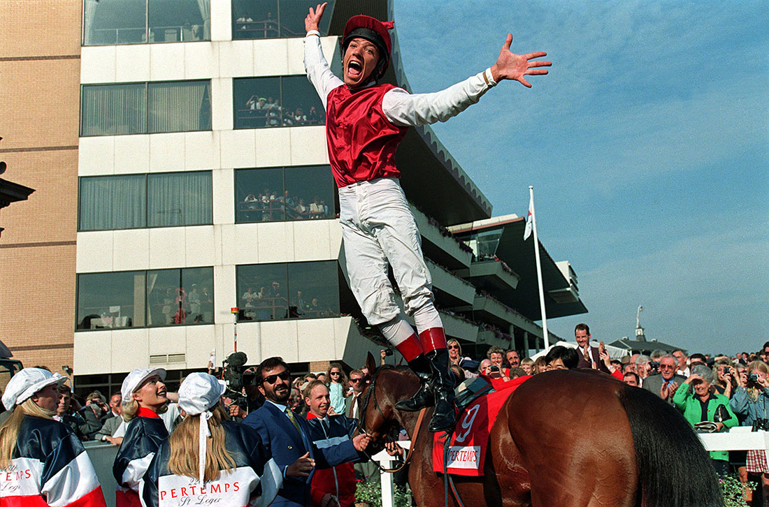 Frankie Dettori leaps off Shantou after victory in the St Leger, Doncaster, 1996