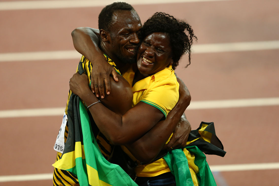Usain Bolt and mother Jennifer Bolt celebrate trackside after winning 100m gold, IAAF World Athletics Championships, Beijing, August 2015