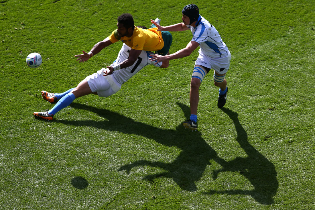 Henry Speight of Australia passes the ball as he is tackled by Rodrigo Silva and Matias Beer of Uruguay, Australia v Uruguay, Villa Park,Rugby World Cup, October 2015