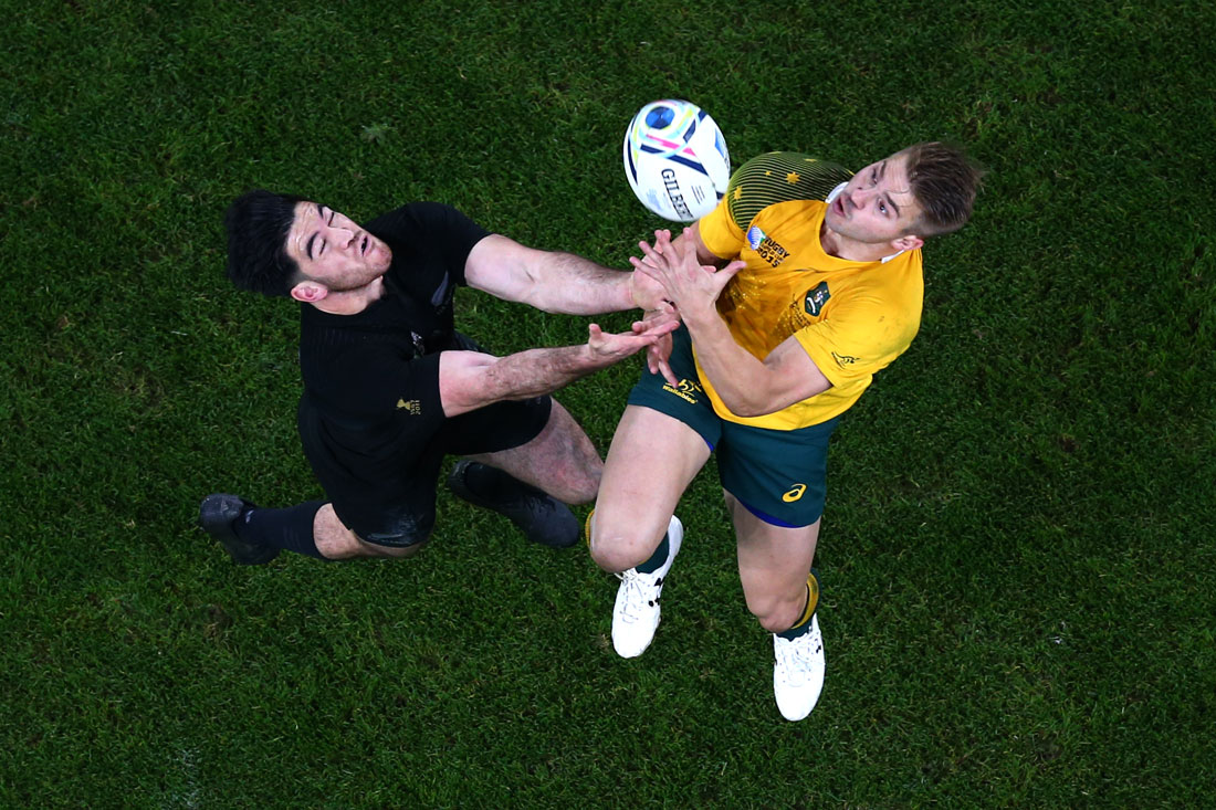 Drew Mitchell of Australia contests a high ball with Nehe Milner-Skudder of New Zealand All Blacks, Rugby World Cup Final,London October 2015