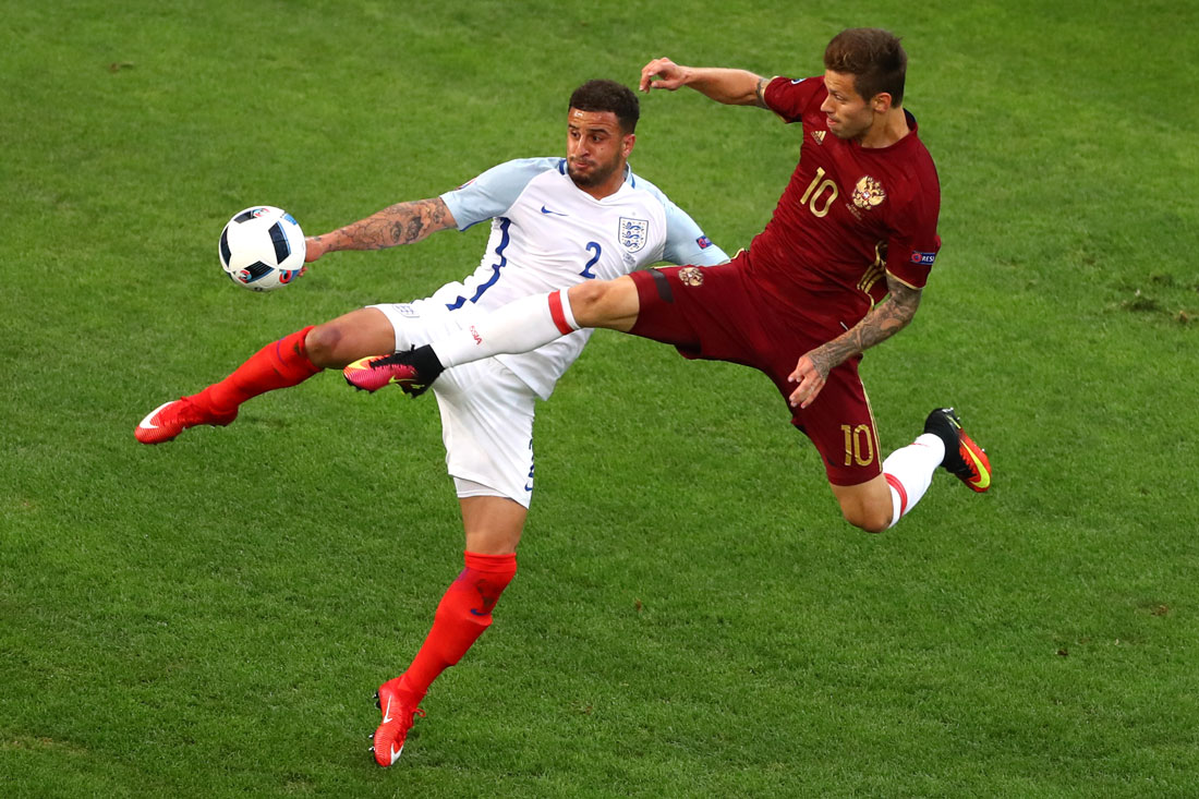Kyle Walker of England challenged by Fedor Smolov of Russia,Euro Championships, Marseille, 11th June 2016