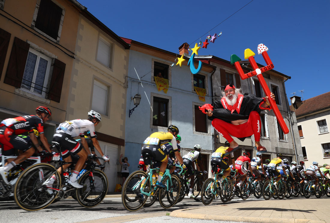 Didi 'The Devil' Senft salutes the cyclists on stage sixteen of Le Tour de France, Moirans-en-Montagne, 18th July 2016