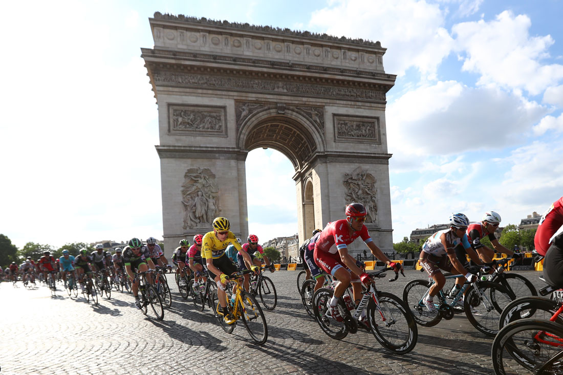 Chris Froome in the winners yellow jersey passes by Arc de Triomphe, 24th July 2016
