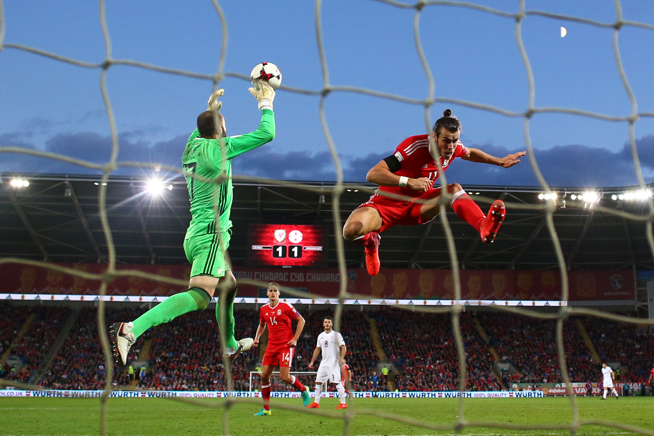 Gareth Bale leaps with Giorgi Loria, Wales v Georgia, World Cup Qualifier,Cardiff, October 2016