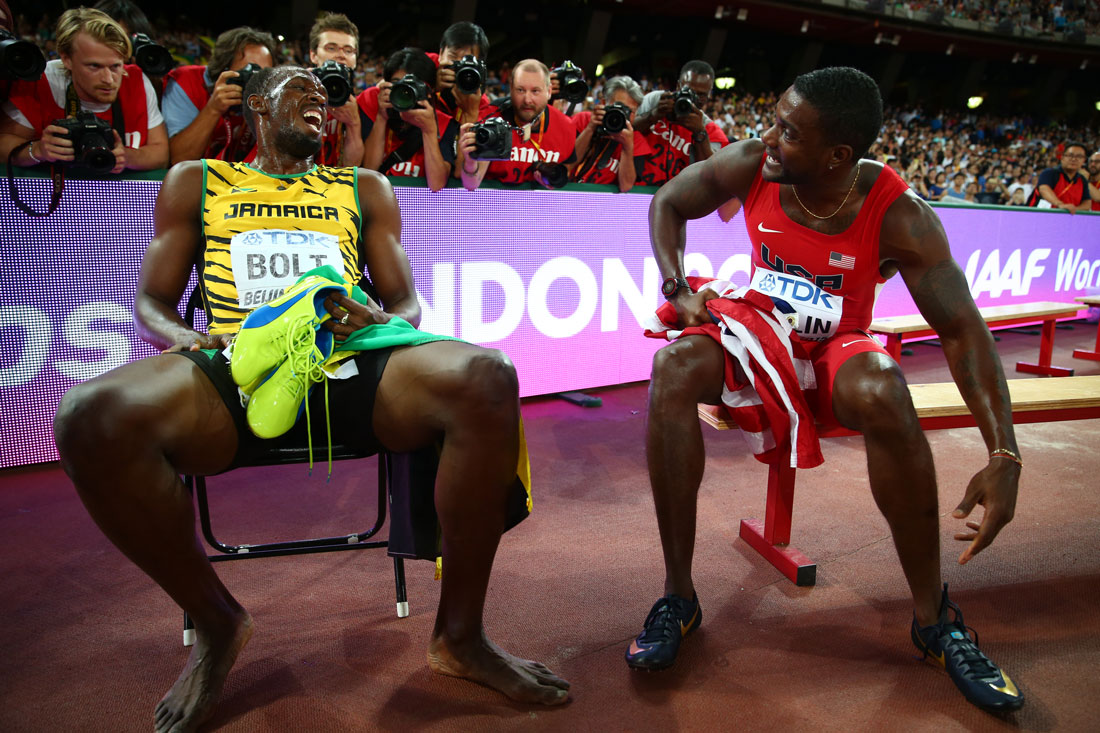 Usain Bolt of Jamaica gold medalist in the 200m final laughs alongside Justin Gatlin of USA, IAAF World Championships, Beijing, August 2015