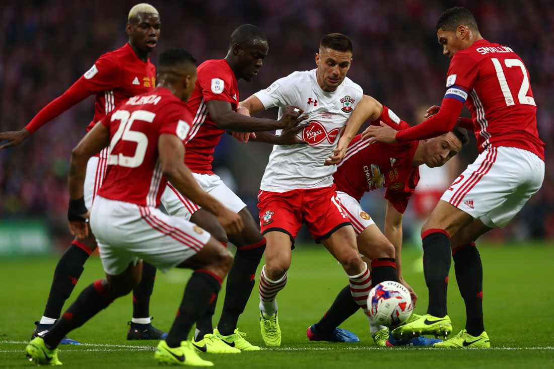 Dusan Tadic of Southampton is surrounded by Manchester United players, EFL Cup Final, Wembley, February 2017