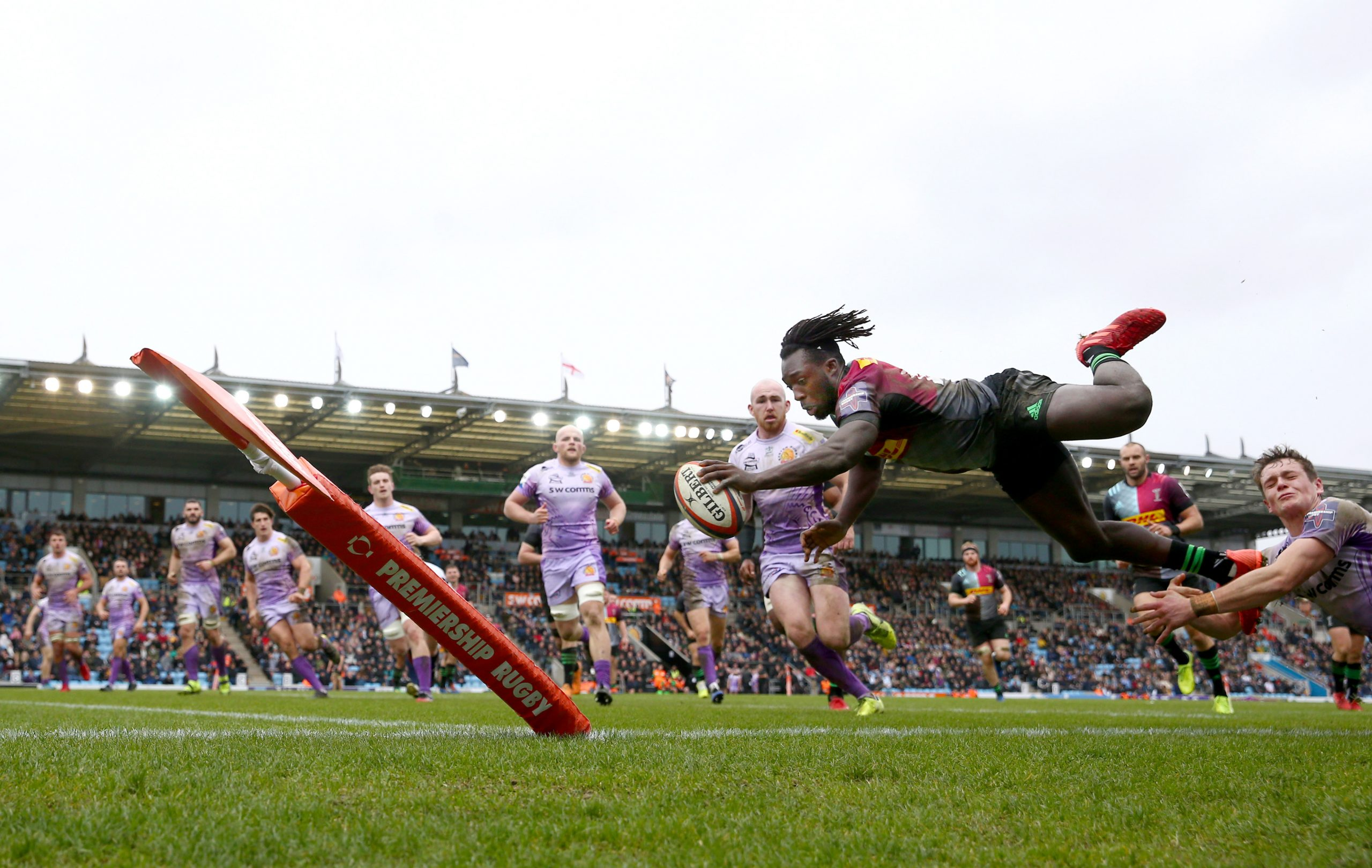 Gabriel Ibitoye of Harlequins dives over to score a try at Sandy Park on February 02, 2020